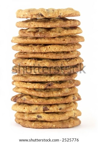 Tall stack of homemade chocolate chip cookies isolated on white background. - stock photo