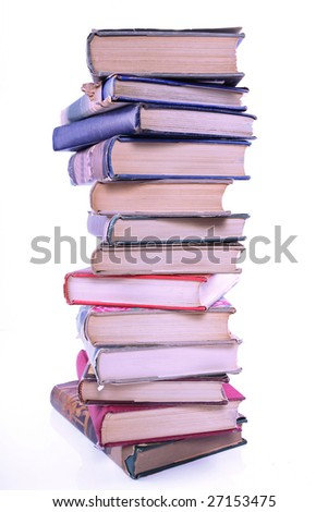 Tall stack of old books - stock photo
