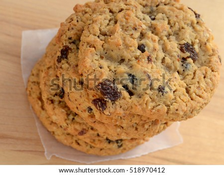 Tall stack of soft oatmeal raisin cookies