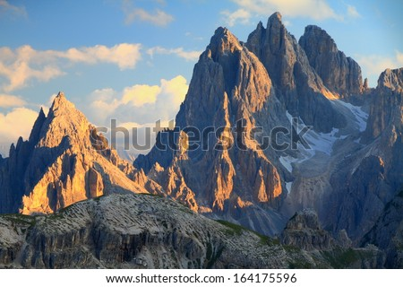 Tall towers of Cadini di Misurina at sunset, Dolomite Alps, Italy - stock photo