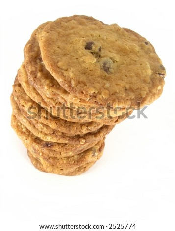 Tall uneven stack of homemade chocolate chip cookies isolated on white background.