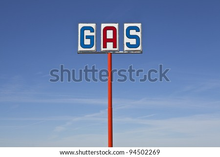 Tall vintage gas sign bight desert light. - stock photo