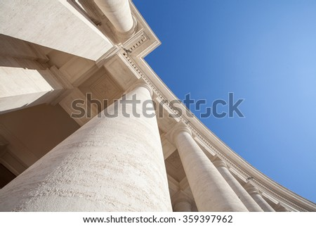 Tall White Columns with Blue Sky