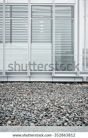 Tall windows on the exterior of a modern building - stock photo