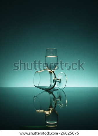 Tall wineglasses against a color background - stock photo
