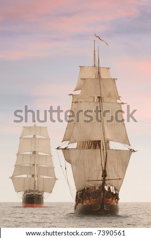 Tall wooden vintage sailing ships shot on the high seas from the front - stock photo