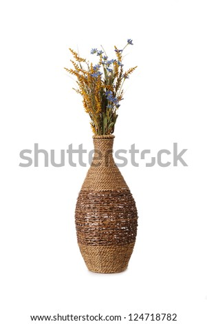 Tall woven basket with Flowers - stock photo