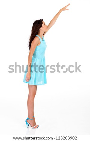 tall young woman reaching for something high - stock photo