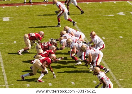 TALLAHASSEE, FL - OCT. 16:  Florida State University players square off against Boston College Eagle players during a football game at Doak Campbell Stadium in Tallahassee, Florida, on Oct. 16, 2010. - stock photo