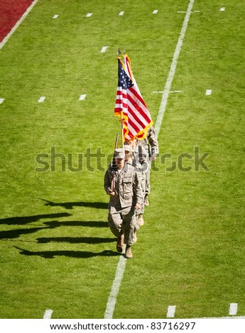 TALLAHASSEE, FL - OCT. 16:  Military recruits walk off football field after national anthem at Florida State University vs. Boston College football game at Doak Campbell Stadium on October 16, 2010.
