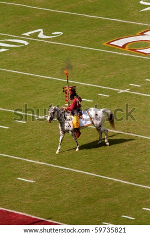 TALLAHASSEE, FL - SEPTEMBER 26:  Chief Osceola riding Renegade prepares to plant flaming spear at midfield at a FSU football game at Doak Campbell Stadium September 26, 2009 in Tallahassee, Florida.