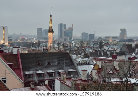 Tallin rooftops in a hazy enening. St. Olafs church - stock photo