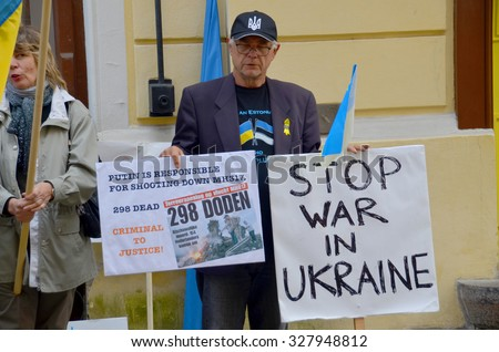 TALLINN ESTONIA 09 27 2015: Anti-Russian against V.Putin protest in connection with military aggression of Russia against Ukraine and flight MH17 Malaysian air line in front the Russian embassy. - stock photo