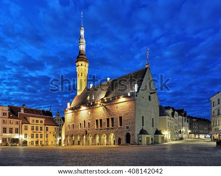 TALLINN, ESTONIA - APRIL 5, 2016: Tallinn Town Hall at dawn. The Tallinn Town Hall is the oldest town hall in the whole of the Baltic region and Scandinavia, it was completed in 1404. - stock photo