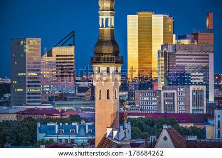 Tallinn, Estonia cityscape with old town hall spire and modern office buildings in the background. - stock photo