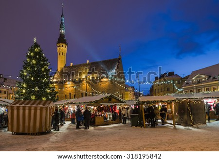 TALLINN, ESTONIA -DECEMBER 26: People enjoy Christmas market in Tallinn on December 26, 2014 In Tallinn , Estonia. It is Estonia oldest Christmas Market with a very long history dating back to 1441. - stock photo