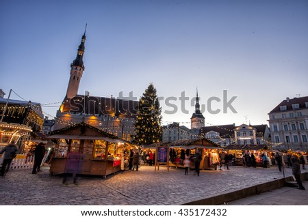 TALLINN, ESTONIA - DECEMBER 12, 2015: Traditional Christmas market in Tallinn old town. HDR image. Long time exposure with motion blur. - stock photo