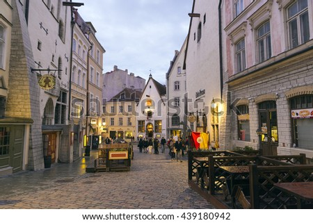 TALLINN, ESTONIA- JUNE 11, 2016: Unidentified people enjoy the streets of the historic center of Tallinn during the white nights, almost at the summer solstice