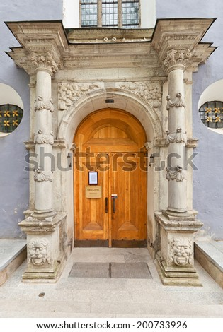 Tallinn, Estonia - May 27, 2014: Decorated portal of side entrance of Saint Nicholas Church (circa XIII c.). Nowadays serves as Art Museum and concert hall. Historic center of Tallinn (UNESCO site)