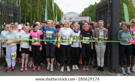 TALLINN, ESTONIA - MAY 23, 2015: Women in the start line at annual women run competition event that holds in the end of May in Pirita, Tallinn, Estonia.