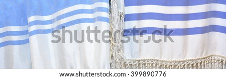 Tallit,  a fringed garment traditionally worn by Jews during Shabbat holidays service pray. Abstract background texture - stock photo