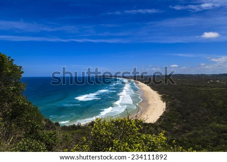 Tallow Beach at Byron Bay NSW Australia. Byron Bay is Australia's most easterly point and a popular travel destination. - stock photo