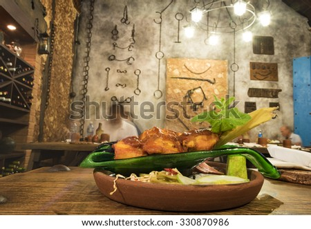 Tamal or tamales beautifully served in private restaurant in Cuba. The new private paladares or restaurant fiercely compete with the government establishments.  - stock photo