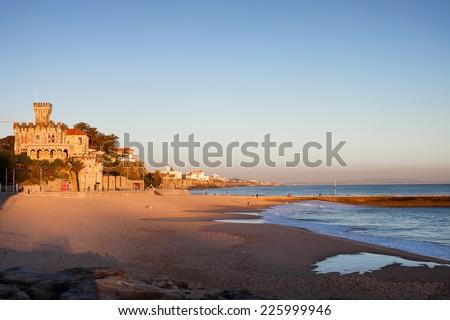 Tamariz Beach at sunset in resort town of Estoril in Portugal. - stock photo