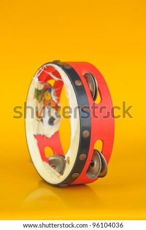 tambourine isolated on a orange background - stock photo