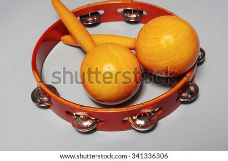 Tambourine, maracas - stock photo