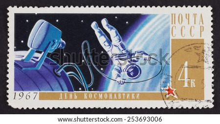 Tambov, Russian Federation - October 02, 2013 USSR postage stamp Cosmonauts Day with astronaut in space. 1967 year. Black background. Cosmonauts' Day in Russia is on April 12th. - stock photo