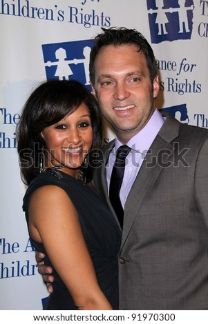 Tamera Mowry and Adam Housley at the 18th Annual Alliance for Children's Rights Dinner Gala, Beverly Hilton Hotel, Beverly Hills, CA. 03-10-11 - stock photo