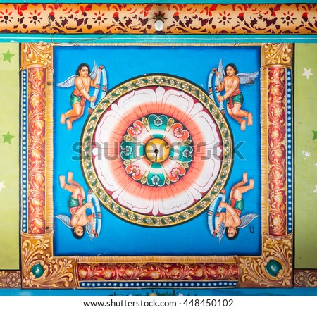 Tamil Nadu, India - October 18, 2013: Pillayarpatti Karpaga Vinayagar temple. Mandalas with angels, aka Kinnaras, and lotus imagery painted on the ceiling of the Mandapam in front of the entrance. - stock photo