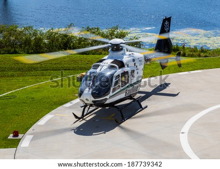 Tampa, Florida April 4th, 2014 Bayflite Trauma Rescue Helicopter sits on the landing pad preparing for take off to respond to a trauma accident scene. - stock photo