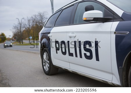 TAMPERE, FINLAND - OCTOBER 12. Finnish police doing traffic enforcement on the side of a road on October 2014.   - stock photo