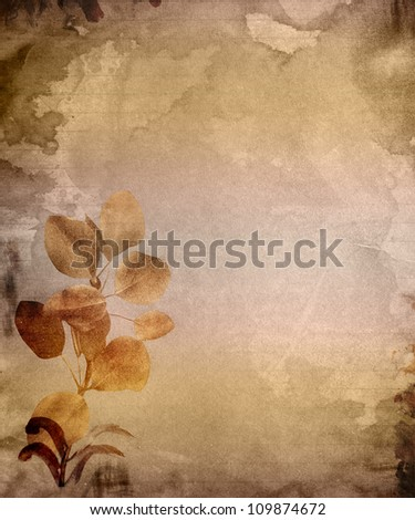 Tan and brown background with the look of aged and stained paper with leaves.