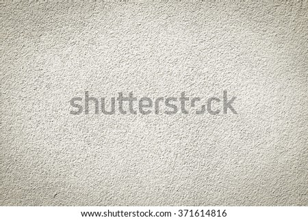 tan cement wallpaper background texture:pure of beige color cement wall background for home interior,design,decorate:clean stucco backdrop.vignette wallpaper concept. - stock photo
