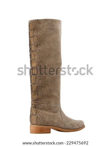 Tan suede female knee boot isolated on white background.