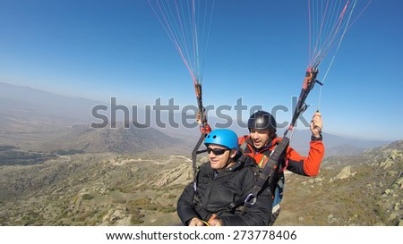 Tandem double paragliding flight - stock photo