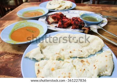 Tandoori chicken, Naan bread - stock photo