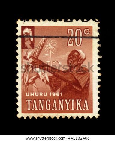 TANGANYIKA - CIRCA 1961: a stamp printed in Tanganyika shows Harvesting Corn, circa 1961 - stock photo