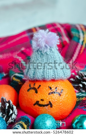 tangerine in a Christmas woolen hat .Xmas New Year concept