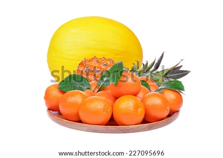 Tangerine, melon and ananas isolated on white background - stock photo