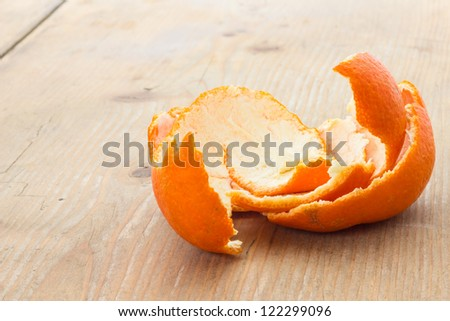 Tangerine peel on the table in front of a window - stock photo