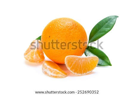 tangerine whole with leaves and some segments on a white background - stock photo