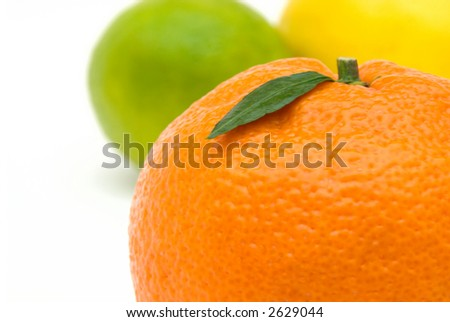 tangerine with green leaf against vivid background made of lime and lemon