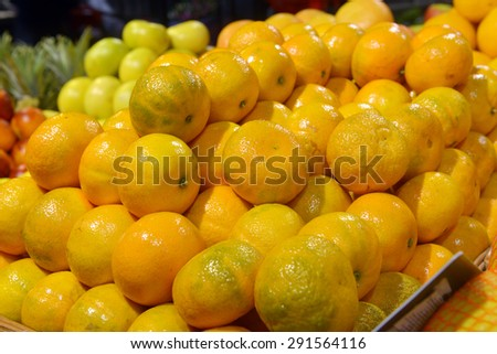 tangerines on display in a supermarket - stock photo