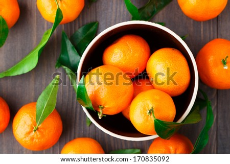 Tangerines on wooden background - stock photo