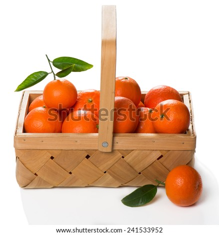 tangerines with fresh leaves in wooden box isolated on white, isolated on a white - stock photo