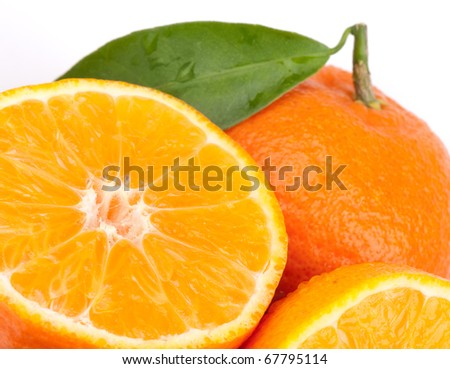 Tangerines with green leaves - stock photo